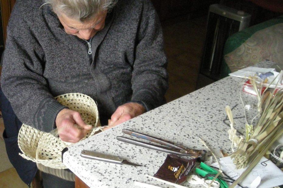 Francesca's grandfather weaving curina to create a basket